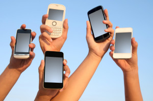 Holding mobile phones - Shutterstock